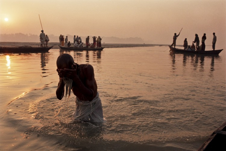 A Devotee washing himself in the sacred lake